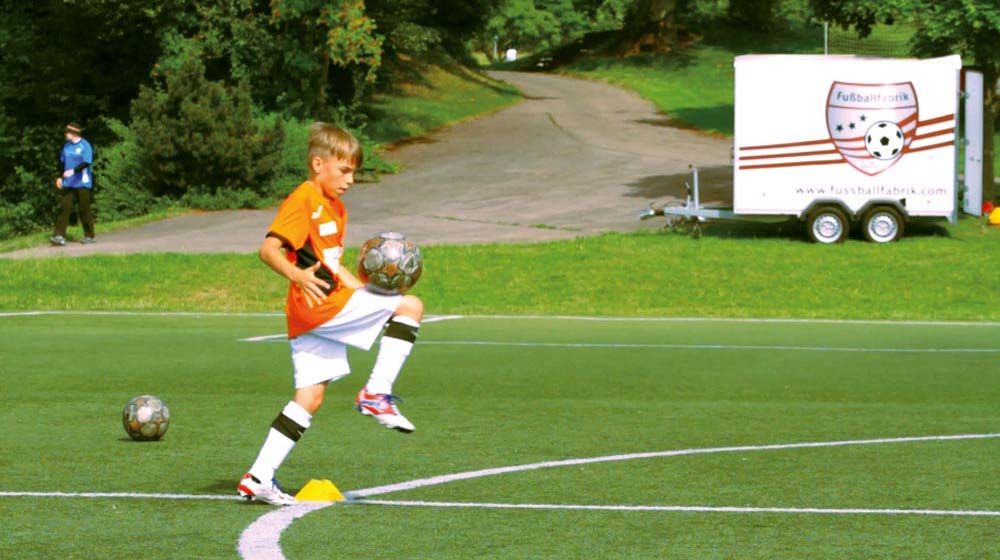 Player repeatedly kicking the ball with his thigh