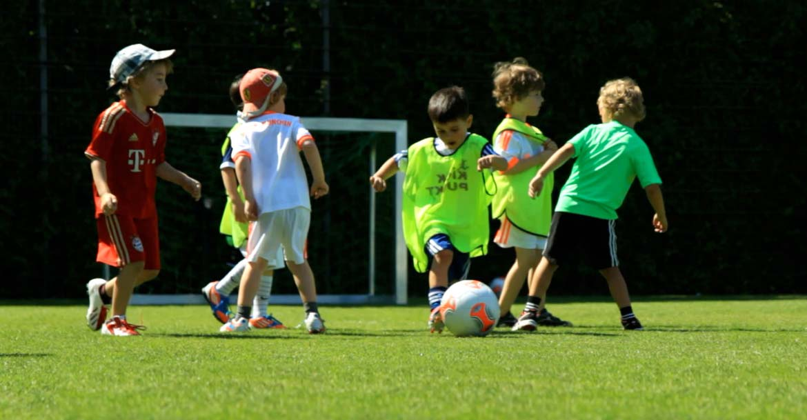 The youngest soccer players only know way - after the ball
